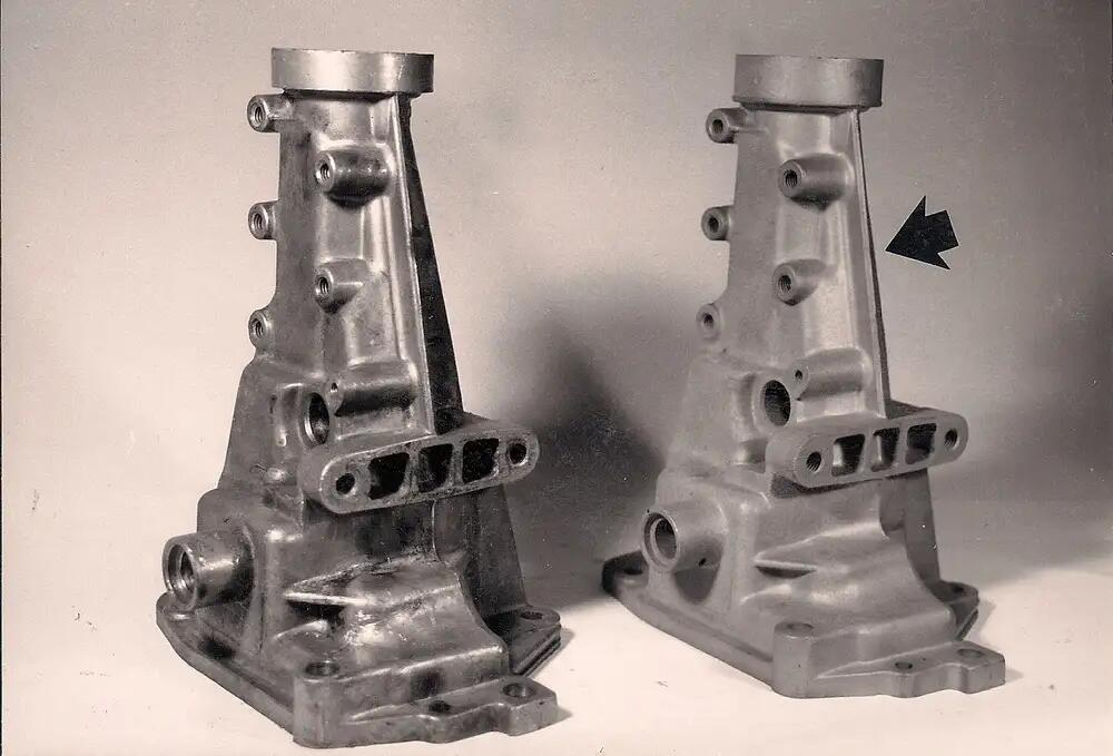 "Early Muncies #3831731 (left) and early #3846429 (right) tailhousings. Note thin parting ""rib""(arrow) on bottom side of early housing."